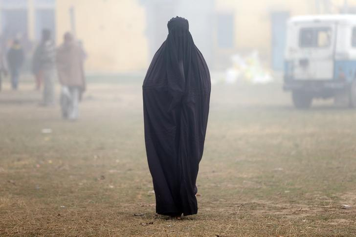 REPRESENTATIVE IMAGE: A woman leaves a polling booth during the state assembly election in Deoband, Uttar Pradesh February 15, 2017. REUTERS/Cathal McNaughton/Files