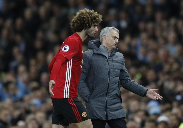 Britain Soccer Football - Manchester City v Manchester United - Premier League - Etihad Stadium - 27/4/17 Manchester United's Marouane Fellaini after being sent off with manager Jose Mourinho  Reuters / Darren Staples Livepic