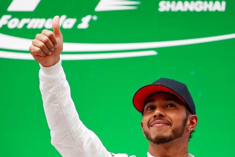 FILE PHOTO - Formula One - F1 - Chinese Grand Prix - Shanghai, China - 09/04/17 - Mercedes driver Lewis Hamilton of Britain celebrates on the podium after winning the Chinese Grand Prix at the Shanghai International Circuit. REUTERS/Aly Song