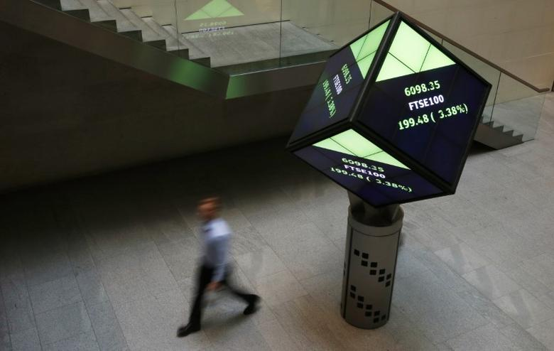A man walks through the lobby of the London Stock Exchange in London, Britain August 25, 2015. REUTERS/Suzanne Plunkett