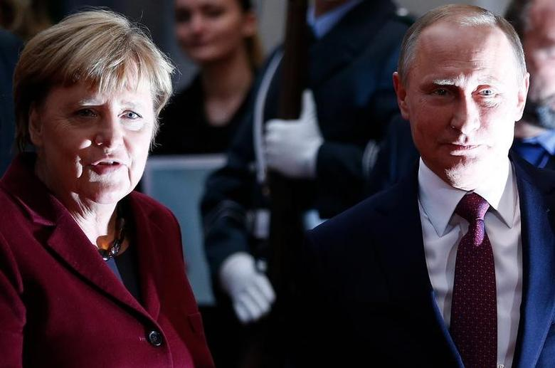 FILE PHOTO: German Chancellor Angela Merkel welcomes Russian President Vladimir Putin for talks at the chancellery in Berlin, Germany, October 19, 2016. REUTERS/Hannibal Hanschke