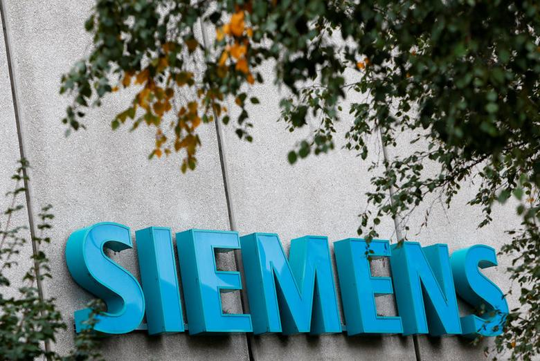 FILE PHOTO: Siemens logo is pictured at Siemens Healthineers headquarters in Erlangen near Nuremberg, Germany, October 7, 2016. REUTERS/Michaela Rehle/File Photo