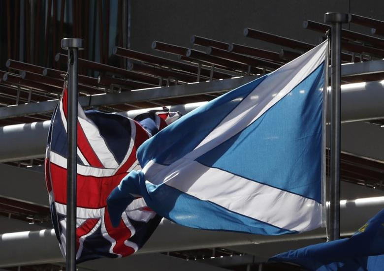 FILE PHOTO: The Union flag and The Scottish Saltire fly at the Scottish Parliament ahead of a referendum debate in Edinburgh Scotland, Britain March 21, 2017. REUTERS/Russell Cheyne