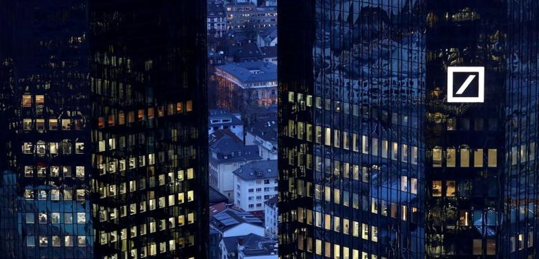 FILE PHOTO: The headquarters of Germany's Deutsche Bank are seen early evening in Frankfurt, Germany, January 31, 2017.   REUTERS/Kai Pfaffenbach/File Photo
