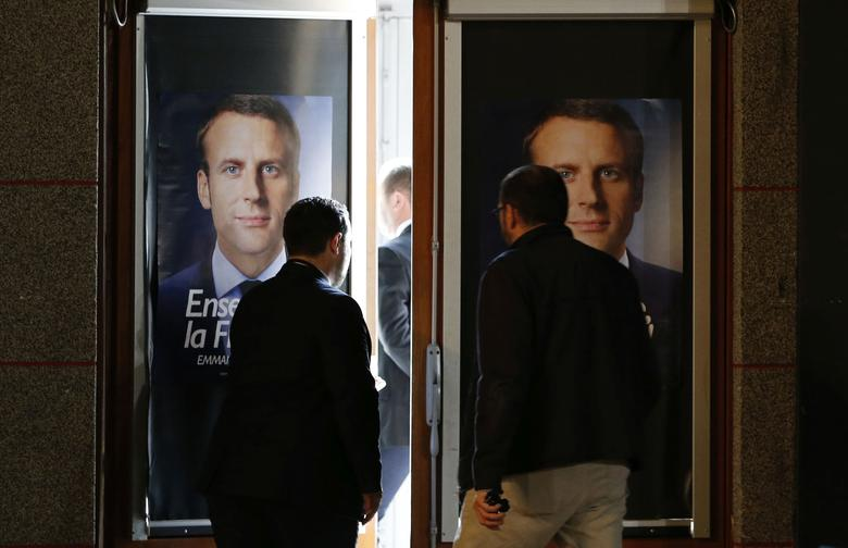 Staff members set up the hall before Emmanuel Macron, head of the political movement En Marche !, or Onwards !, and candidate for the 2017 presidential election, attends a campaign rally in Chatellerault, France, April 28, 2017. REUTERS/Regis Duvignau