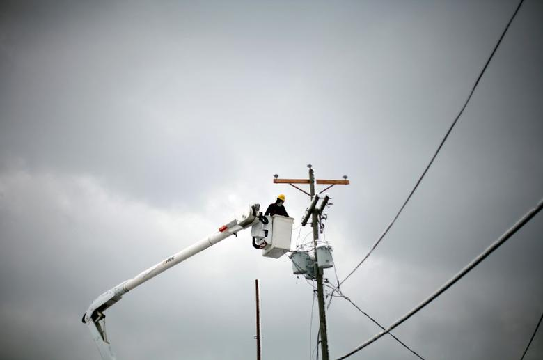 A utility worker is seen in West Liberty, Kentucky, March 5, 2012. REUTERS/Eric Thayer