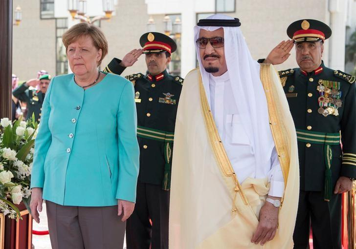 Saudi Arabia's King Salman bin Abdulaziz Al Saud stands next to German Chancellor Angela Merkel during a reception ceremony in Jeddah, Saudi Arabia April 30, 2017. Bandar Algaloud/Courtesy of Saudi Royal Court/Handout via REUTERS