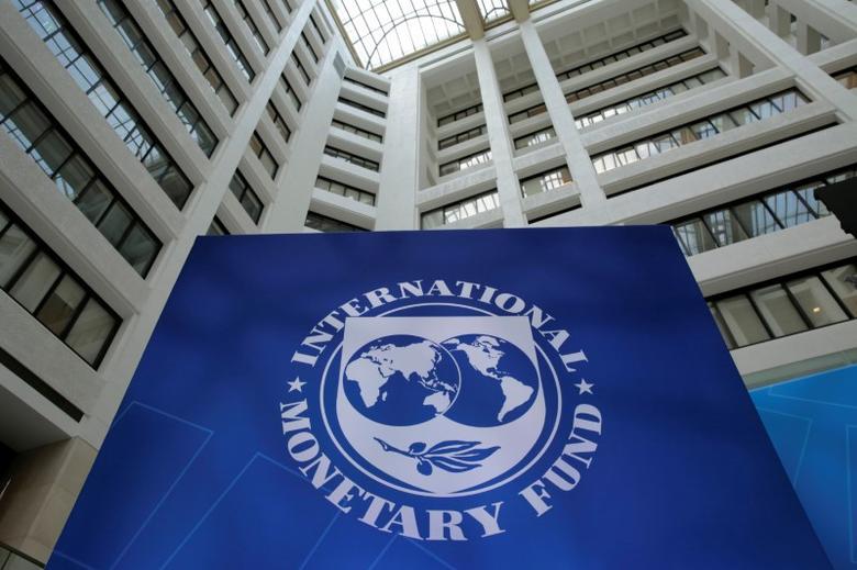 FILE PHOTO: The International Monetary Fund logo is seen during the IMF/World Bank spring meetings in Washington, U.S., April 21, 2017. REUTERS/Yuri Gripas