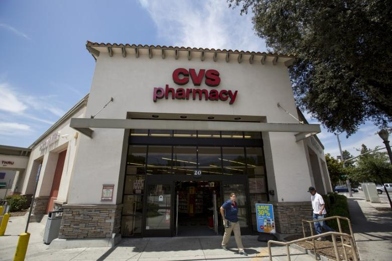 FILE PHOTO: People walk outside a CVS store in Pasadena, California, August 3, 2015. REUTERS/Mario Anzuoni/File Photo