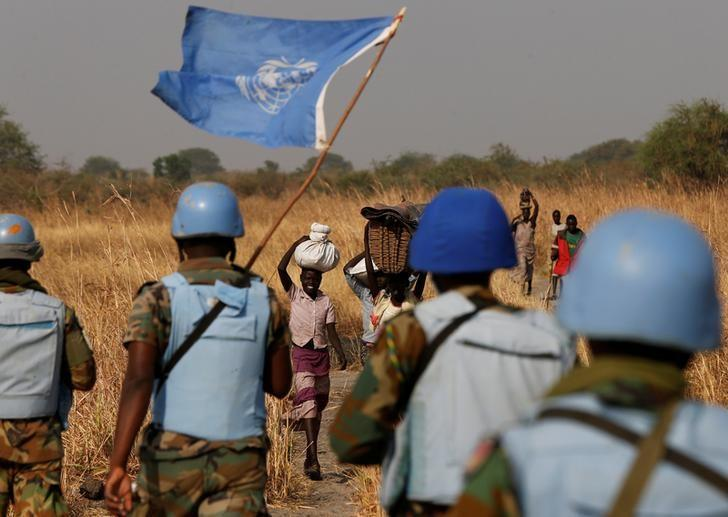 FILE PHOTO: United Nations Mission in South Sudan (UNMISS) peacekeepers meet women and children on their path during a patrol near Bentiu, northern South Sudan, February 11, 2017. REUTERS/Siegfried Modola