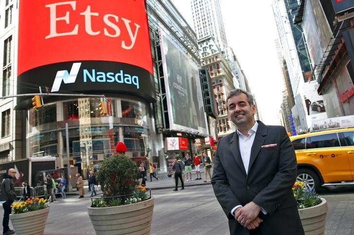 Etsy Inc's Chief Executive Officer Chad Dickerson poses outside the Nasdaq market site in Times Square following Etsy's initial public offering (IPO) in New York April 16, 2015. REUTERS/Mike Segar