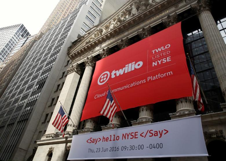 FILE PHOTO - A banner for communications software provider Twilio Inc., hangs on the facade of the New York Stock Exchange (NYSE) to celebrate the company's IPO in New York City, U.S., June 23, 2016. REUTERS/Brendan McDermid