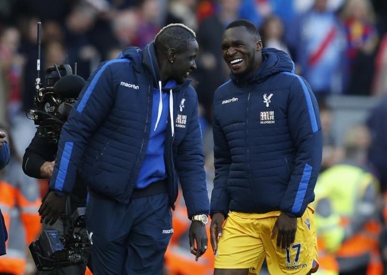 Britain Football Soccer - Liverpool v Crystal Palace - Premier League - Anfield - 23/4/17 Crystal Palace's Christian Benteke and Mamadou Sakho celebrate after the match  Reuters / Phil Noble Livepic