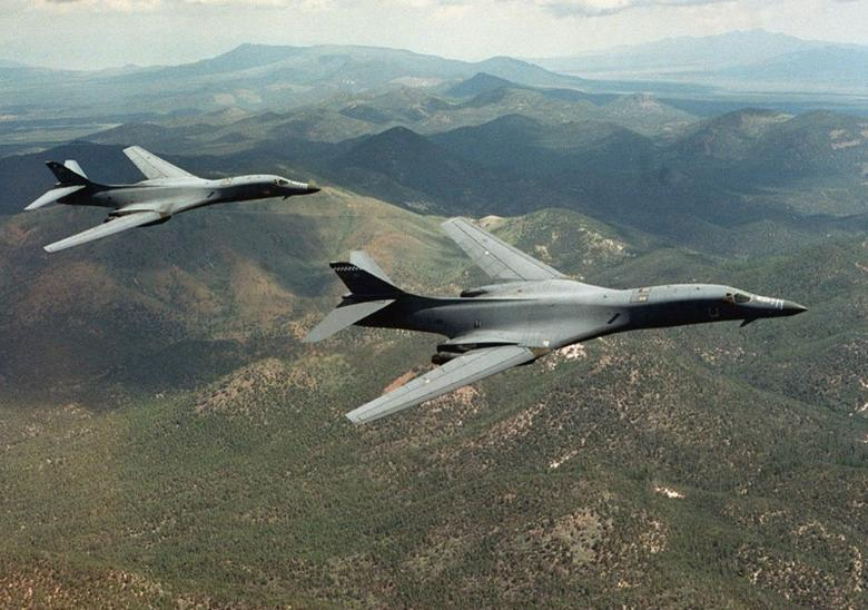 FILE PHOTO: A pair of B-1B Lancer bombers soar over Wyoming in an undated file photo. Staff Sgt. Steve Thurow/U.S. Air Force/Handout via REUTERS/File photo