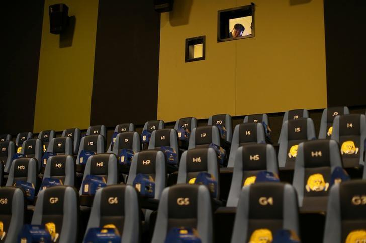 A movie projectionist looks out from his projection room in a newly-built Cinepolis theatre for children and families  in Pico Rivera, California, U.S., March 15, 2017.    REUTERS/Mike Blake