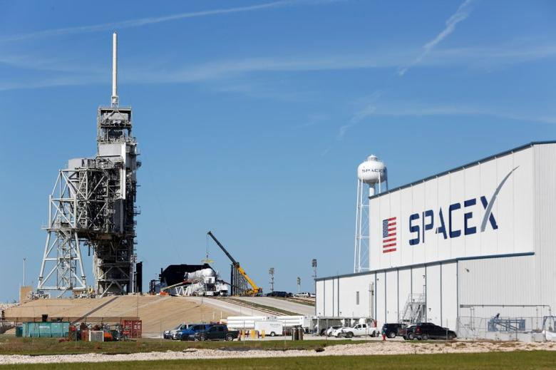 FILE PHOTO: A SpaceX Falcon 9 rocket (in center, in a horizontal position), is readied for launch on a supply mission to the International Space Station on historic launch pad 39A at the Kennedy Space Center in Cape Canaveral, Florida, U.S., February 17, 2017. Launch is scheduled for February 18. REUTERS/Joe Skipper
