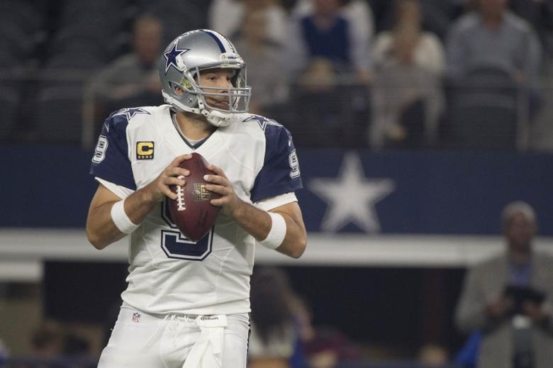 Dallas Cowboys quarterback Tony Romo (9) drops back to pass against the Carolina Panthers during the first quarter of an NFL game on Thanksgiving at AT&T Stadium. Mandatory Credit: Jerome Miron-USA TODAY Sports  / Reuters Picture Supplied by Action Images