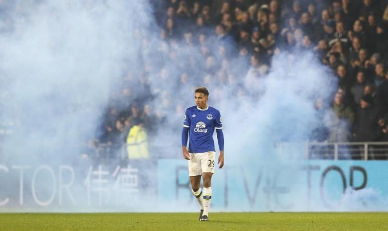 Britain Football Soccer - Hull City v Everton - Premier League - The Kingston Communications Stadium - 30/12/16 Everton's Dominic Calvert-Lewin as fans let off a flare Action Images via Reuters / Jason Cairnduff/ Livepic/ Files