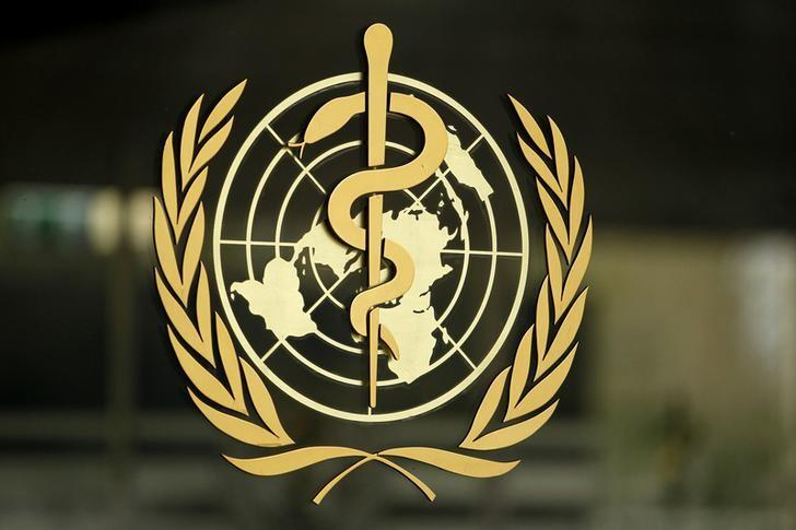 The World Health Organization (WHO) logo is pictured at the entrance of its headquarters in Geneva, January 25, 2015. REUTERS/Pierre Albouy