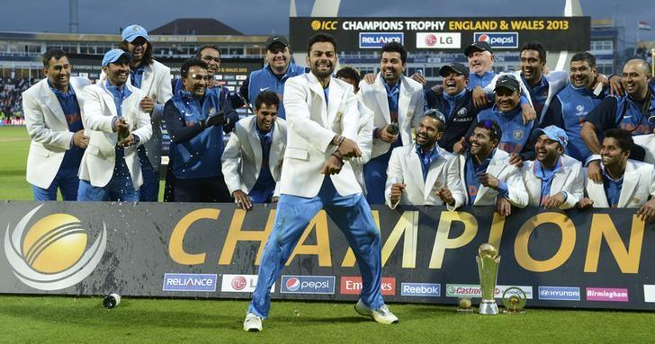 India's Virat Kohli dances after his team won the ICC Champions Trophy final cricket match against England at Edgbaston cricket ground in Birmingham June 23, 2013. REUTERS/Philip Brown/Files