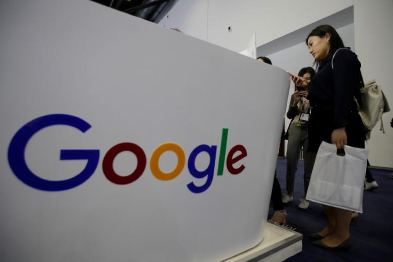 FILE PHOTO: People visit Google's booth at the Global Mobile Internet Conference (GMIC) 2017 in Beijing, China April 28, 2017. REUTERS/Jason Lee