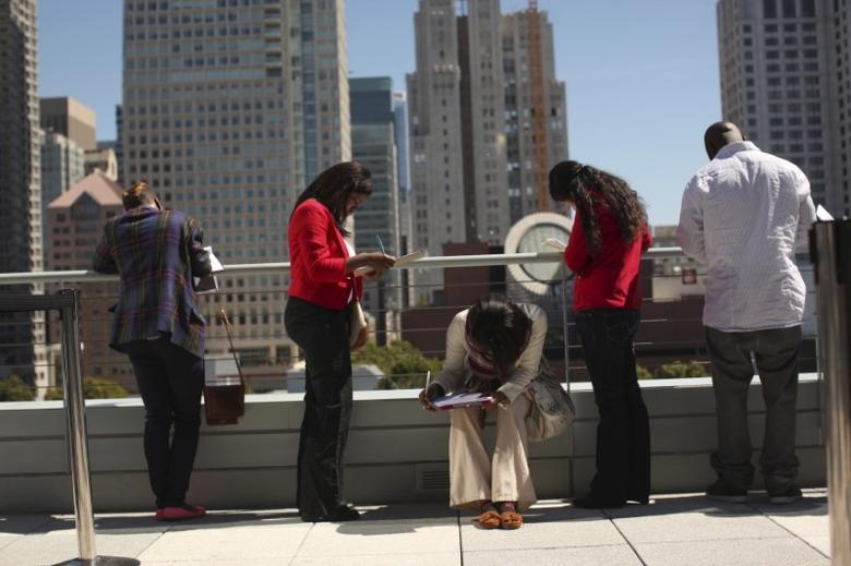 Job seekers apply for the 300 available positions at a new Target retail store in San Francisco, California August 9, 2012.    REUTERS/Robert Galbraith/File Photo