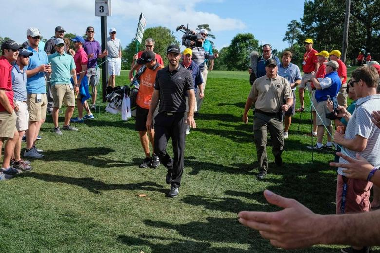 May 5, 2017; Wilmington, NC, USA; Dustin Johnson is cheered by gallery on third green during the second round of the Wells Fargo Championship golf tournament at Eagle Point Golf Club. Mandatory Credit: Jim Dedmon-USA TODAY Sports