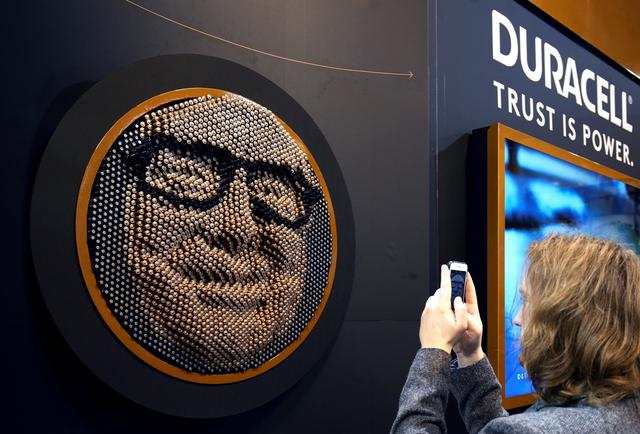 A Berkshire Hathaway shareholder takes a picture of a portrait of Berkshire CEO and chairman Warren Buffet made out of Duracell batteries at the Berkshire Hathaway annual meeting in Omaha, Nebraska, U.S. May 6, 2017. REUTERS/Rick Wilking