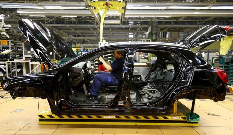 An employee of German car manufacturer Mercedes Benz works on the interior of a GLA model at their production line at the factory in Rastatt, Germany, January 22, 2016.    REUTERS/Kai Pfaffenbach/File Photo -