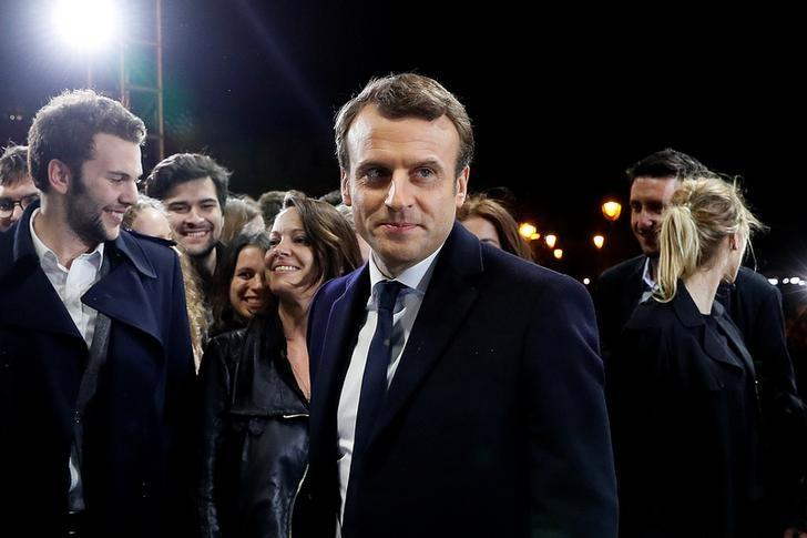 French President elect Emmanuel Macron reacts after he delivered a speech during his victory rally near the Louvre museum after results in the 2017 presidential election in Paris, France, May 7, 2017.    REUTERS/Thomas Samson/Pool