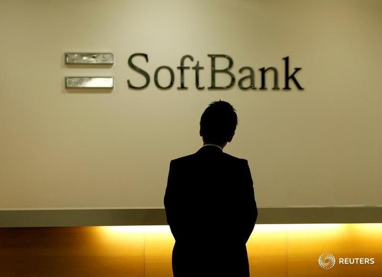 A man looks at the logo of SoftBank Group Corp at the company's headquarters in Tokyo, June 30, 2016.   REUTERS/Toru Hanai/File Photo