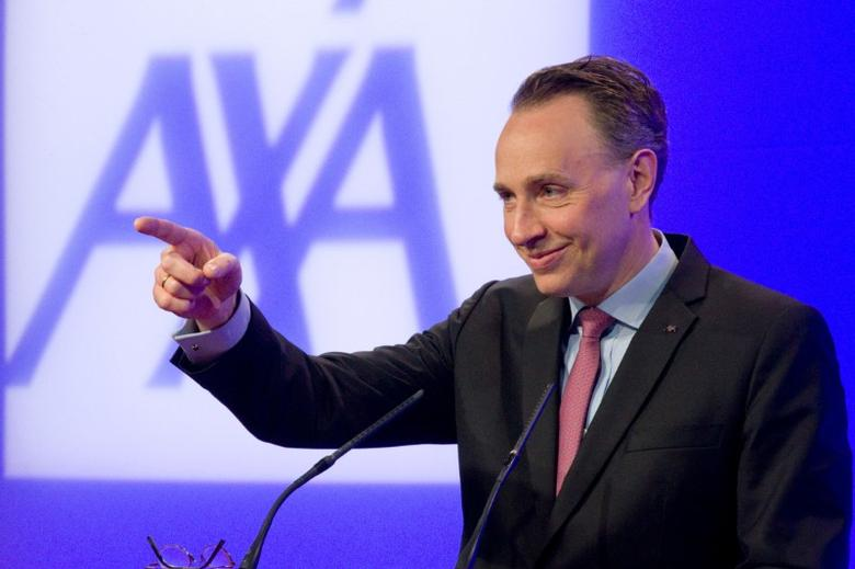 Thomas Buberl, CEO of French insurer AXA, gestures as he speaks during the company's 2016 annual results presentation in Paris, France, February 23, 2017. REUTERS/Charles Platiau - RTSZYS5