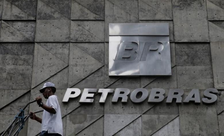 FILE PHOTO: A man walks past the Brazil's state-run Petrobras oil company headquarters in Rio de Janeiro, Brazil April 13, 2017. REUTERS/Ricardo Moraes