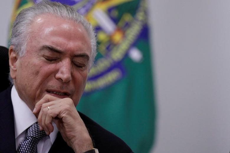 Brazil's President Michel Temer reacts during a meeting with government leaders of the Brazilian federal senate, at the Planalto Palace in Brasilia, Brazil May 9, 2017. REUTERS/Ueslei Marcelino