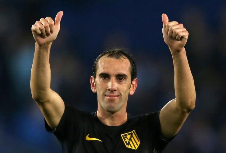 Soccer Football - Espanyol v Atletico Madrid - Spanish La Liga Santander - RCDE stadium, Cornella-El Prat (Barcelona), Spain - 22/04/2017. Atletico Madrid's Diego Godin  celebrates their victory at the end of the match. REUTERS/Albert Gea
