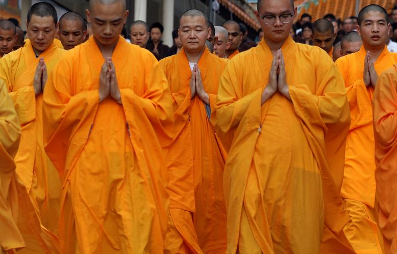 Buddhist monks perform the