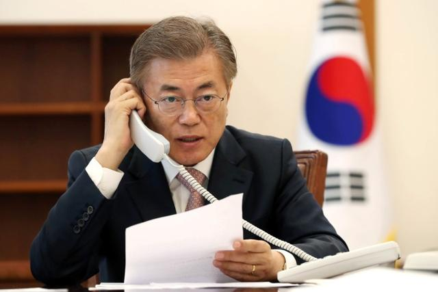 South Korean President Moon Jae-in speaks with Chinese President Xi Jinping by telephone at the Presidential Blue House in Seoul, South Korea in this handout picture provided by the Presidential Blue House and released by Yonhap on May 11, 2017. Blue House/Yonhap via REUTERS