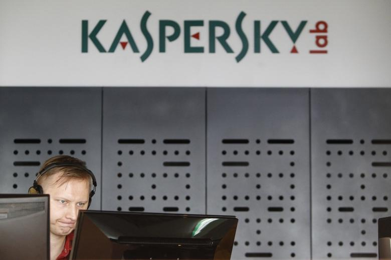 FILE PHOTO: An employee works near screens in the virus lab at the headquarters of Russian cyber security company Kaspersky Labs in Moscow July 29, 2013. REUTERS/Sergei Karpukhin