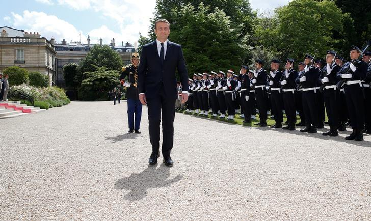 French President Emmanuel Macron reviews troops as he attends a flag ceremony in the garden of the Elysee Palace after his inauguration in Paris, France, May 14, 2017.   REUTERS/Gonzalo Fuentes