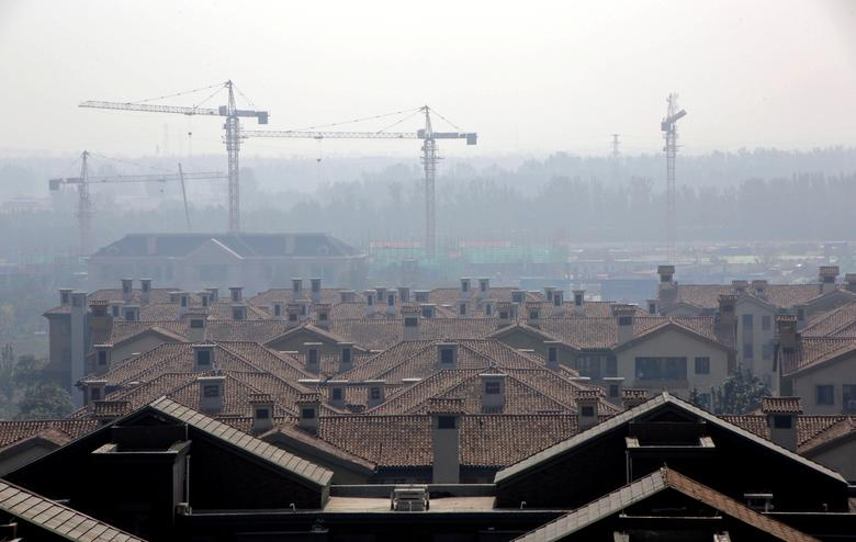 FILE PHOTO: Apartment blocks are pictured in Wuqing District of Tianjin, China October 10, 2016. REUTERS/Jason Lee/File Photo