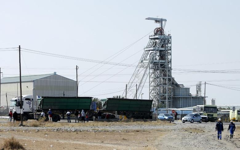 FILE PHOTO: Workers leave Lonmin's Karee mine at the end of their shift, outside Rustenburg, northwest of Johannesburg July 29, 2015. REUTERS/Siphiwe Sibeko