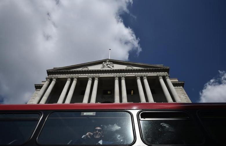 A bus passes the Bank of England in the City of London, Britain April 19, 2017. Sterling basked in the glow of a six-month high following Tuesday's surprise news of a snap UK election. REUTERS/Hannah McKay