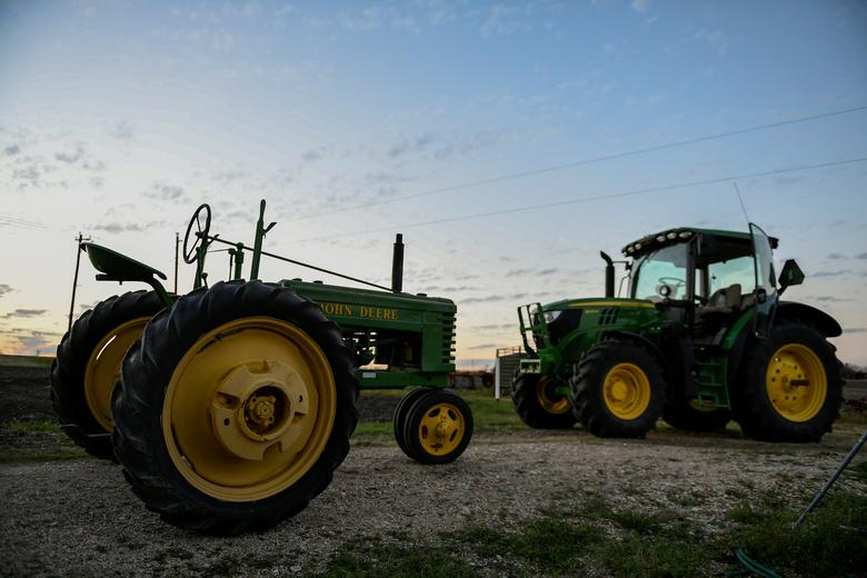 FILE PHOTO: John Deere equipment is seen at a dealership in Taylor, Texas, U.S., February 16, 2017. Picture taken February 16, 2017. REUTERS/Mohammad Khursheed/File Photo