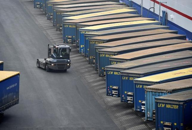 Containers are pictured at a loading terminal in the port of Kiel, Germany, January 25, 2017. REUTERS/Fabian Bimmer