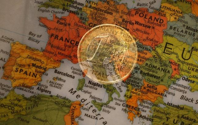 A picture illustration taken with the multiple exposure function of the camera shows a one Euro coin and a map of Europe, January 9, 2013. REUTERS/Kai Pfaffenbach