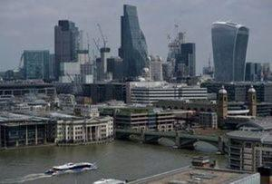 FILE PHOTO: A view of landmark buildings in the City of London financial district, including the Leadenhall Building, known locally as 'the Cheesegrater', and 20 Fenchurch Street, known as 'the Walkie-Talkie', because of their distinctive shapes. REUTERS/Hannah McKay/File Photo