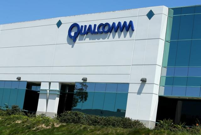 FILE PHOTO: A Qualcomm sign is pictured at one of its many campus buildings in San Diego, California, U.S. April 18, 2017.  REUTERS/Mike Blake