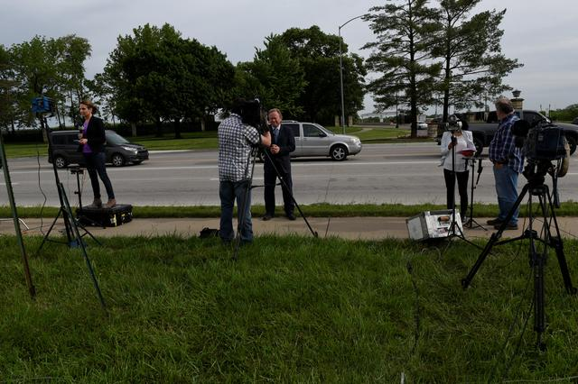 Members of the media report on the release of Chelsea Manning outside of Fort Leavenworth, in Leavenworth Kansas, U.S. May 17, 2017. REUTERS/Nick Oxford