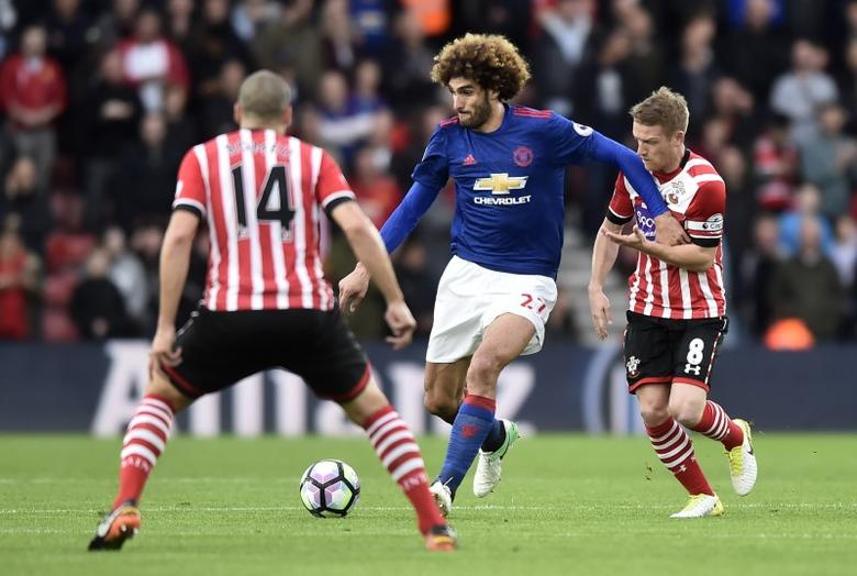 Britain Football Soccer - Southampton v Manchester United - Premier League - St Mary's Stadium - 17/5/17 Manchester United's Marouane Fellaini in action with Southampton's Steven Davis  Reuters / Hannah McKay Livepic