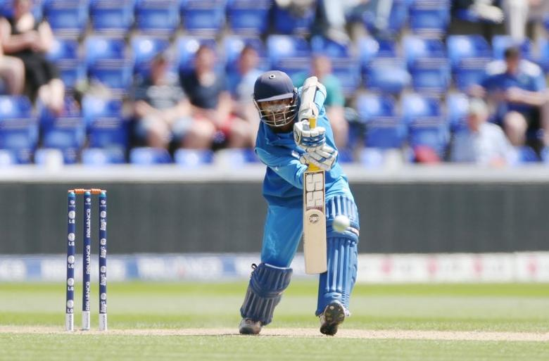 Cricket - Australia v India - ICC Champions Trophy Warm-Up Match - Cardiff - 4/6/13 India's Dinesh Karthik in action Mandatory Credit: Action Images / Paul Childs